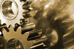 Gears and cogs in brown Stock Image