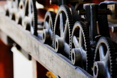 Gears & Cogs. Close up of the gears on an old printing press.  This machine reliably printed artwork and art notices over 100 years ago.  With a little care Royalty Free Stock Photos