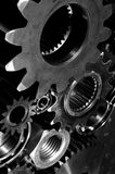 Gears and cogs, hi tech idea. Large arrangement of gears and cogs in a dark duplex toning concept Stock Image