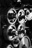 Gears and Cogs - noir grunge. Image of gears and cogs in an industrial setting Royalty Free Stock Photography