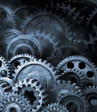 Gears Cogs Retro Industrial Background. A retro black and white background of industrial cogs or gears with movement royalty free stock images