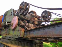 Gears, cogs and steel cables. The working parts of a vintage mobile railway crane on a preserved railway in England Stock Images