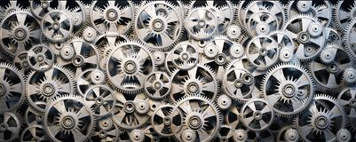 Gears and cogwheels. Background of 3d metal gears and cogwheels Stock Photo