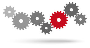 Gears for cooperation symbolism. Gray gears for cooperation or teamwork symbolism with red leader Stock Images
