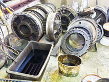 Gears of disassembled engine in workshop Stock Photography