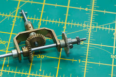 Gears. On the drawing mat Stock Photos