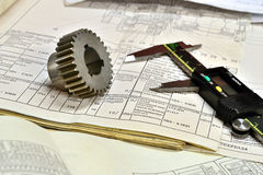 Gears and electronic calliper Royalty Free Stock Images