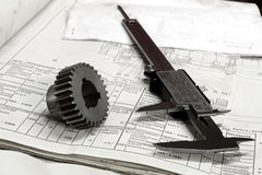 Gears and electronic calliper Royalty Free Stock Photo