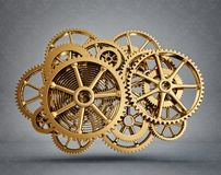 Gears. Golden gears isolated on a grey background Stock Photos