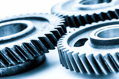 Gears, grunge cogwheels, real engine elements on white. Heavy industry Stock Photo