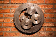 Gears hanging on the wall Royalty Free Stock Photos