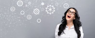 Gears with happy young businesswoman Royalty Free Stock Image