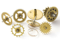 Gears hours. The mechanism of hours on a white background metal golden color Stock Photos