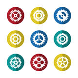Gears icon set on colorful circles Stock Photos