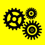 Gears icon. On yellow background Royalty Free Stock Images