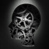 Gears inside a head. Cog wheels and gear inside a head shape -psychology and creativity concept illustration Royalty Free Stock Photo