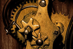 Gears Inside an Old Grandfather Clock. Close-up showing the gears inside an old grandfather clock royalty free stock photography