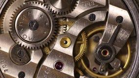Gears inside old mechanic pocket watch stock video footage