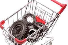 Gears inside shopping trolley Stock Photo