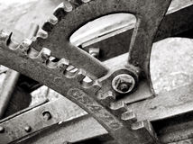 Gears and levers on old plow. Gears and levers on old farm plow - black and white toning Stock Image
