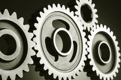 Gears. Machinery- Different sizes of Gears Stock Photos