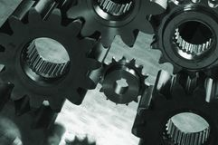 Gears-machinery, slightly silhouetted royalty free stock image