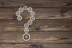 Gears made of wood, question mark Royalty Free Stock Images