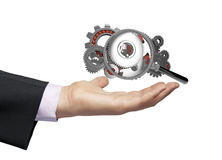 Gears magnifying glass businessman Stock Photos