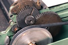 Gears mechanism with band. Vintage gears mechanism with band attached royalty free stock photography