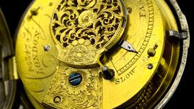 Gears the mechanism of a vintage pocket watchl. Close up. Back background. Sound. Gears and mainspring in the mechanism of a vintage pocket watchl. Close up stock footage
