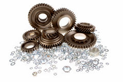 Gears and nuts Stock Images
