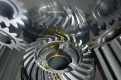 Gears in oil reflection seen from above stock images