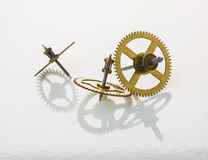 Gears from old clock isolated on white background Stock Photo
