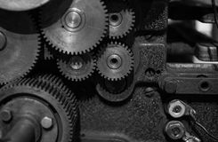 The gears of a old and vintage machine Stock Photos