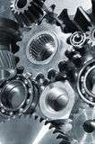 Gears and pinions in blue Stock Photos