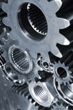 Gears and pinions in blue Stock Images