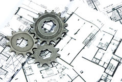 Gears and plans. Some geras on the plans background Royalty Free Stock Images