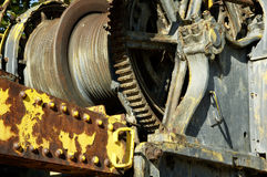 Gears and pullys. Grungy abandoned industrial equipment with rust and peeling paint Stock Images