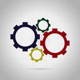 Gears red, green, yellow and blue on a grey background Royalty Free Stock Image