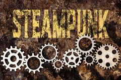 Gears on rusty background, word steampunk Stock Images