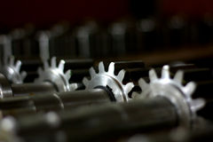Gears with shaft low-key Royalty Free Stock Images