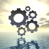 Gears on a shiny sunset sea Stock Photography