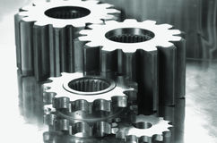 Gears in a shiny titanium assembly Stock Photo