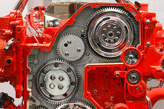 Gears. Silver gears in red transmission box machine Royalty Free Stock Images