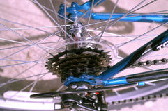 Gears and spokes. Picture of the back wheel hub of a bicycle Royalty Free Stock Photo