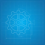 Gears symbol on the drawing paper. Paper blueprint background. Gears symbol on the drawing paper. Concept of motion and mechanics, connection and operation Royalty Free Stock Photo