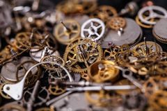 Gears on the table. Details, technology. Heap of small gears on the table Royalty Free Stock Image