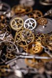 Gears on the table. Details, technology. Heap of small gears on the table Stock Photo