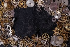 Gears on the table. Details, technology. Heap of small gears on the table Royalty Free Stock Images