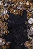 Gears on the table. Details, technology. Heap of small gears on the table Royalty Free Stock Photo